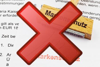 """Ein Stempel mit der Aufschrift """"Markenschutz"""" versehen mit einem roten Kreuz für """"unzulaessig"""""""